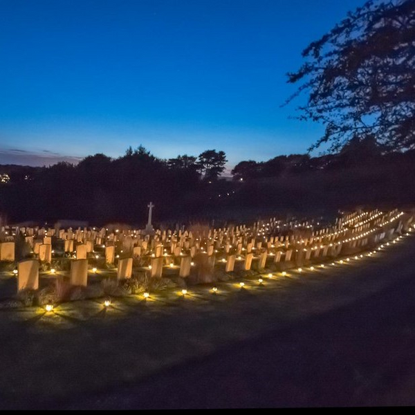 Shorncliffe Military Cemetery lit by lanterns (The Shorncliffe Trust)