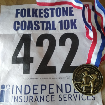 Folkestone Coastal 10km run - runners number and medal
