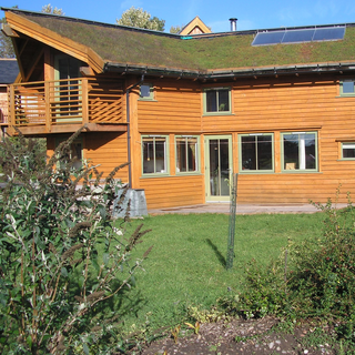 John Willoner's Eco-House at Findhorn. Turf roof, passive solar, solar panel.