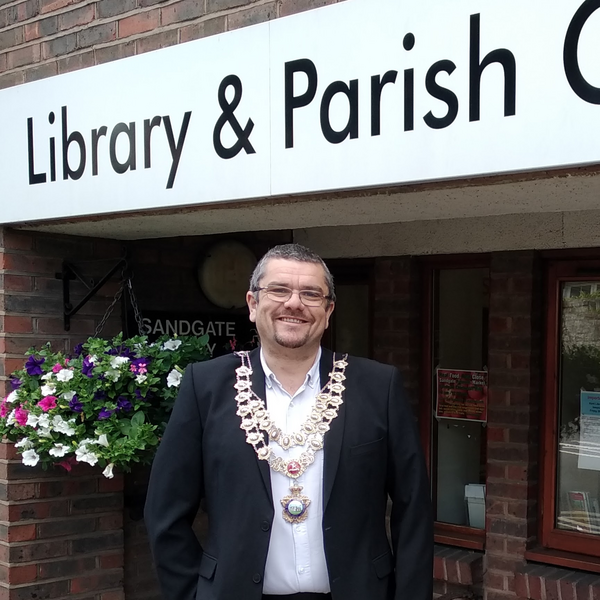 Tim Prater in front of Sandgate Library and Parish Council Office